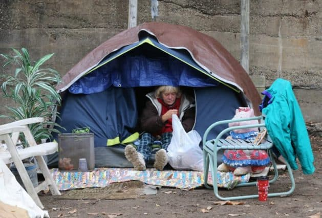 Neighbor sues to shut down Akron's largest tent city for the homeless