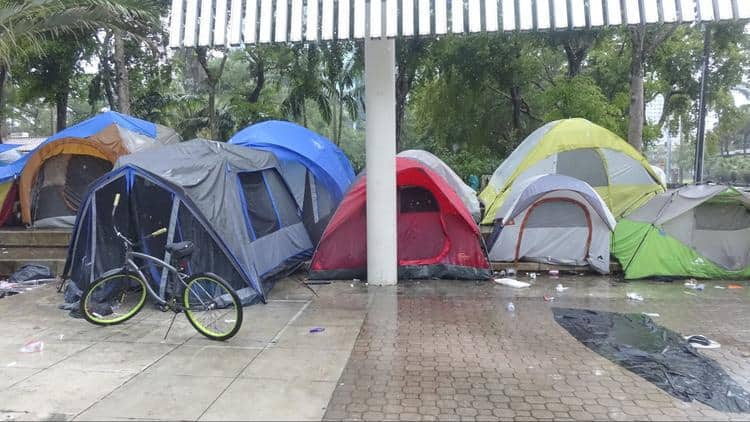 Rain floods the tents, drains the spirits at downtown Fort Lauderdale's homeless camp