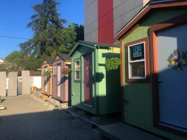 Once homeless and helpless, woman now helps build 'tiny homes' for others like her